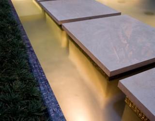 How a Contemporary Garden was designed around a Central Koi Pond